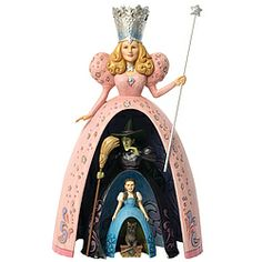 """Entitled """"Spellbound,"""" this masterful set of nesting dolls features Glinda, the Wicked Witch, Dorothy, and her little dog Toto."""
