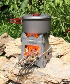 Going on a camping trip or any outdoor adventure is much easier when our Take-A-Long Camping Stove is in tow. This awesome little camping accessory is made from heavy-duty titanium steel that is completely resistant to corrosion. It only takes a few secon Camping Wood Stove, Camping Table, Outdoor Camping, Tent Stove, Outdoor Gear, Bushcraft Camping, Camping Gear, Camping Foods, Backpacking