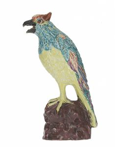 Salt-glazed stoneware figure of a crested bird perched on a rock, painted in enamel colours: English, Staffordshire, c. 1760.