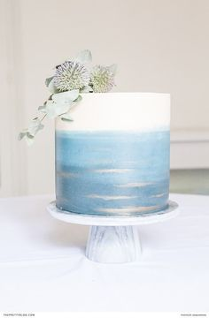 This simple, one-tier cake boasted a whimsical watercolour effect in shades of pastel and dusty blue. | Photographer: Sonja Koning Photography | Confectioner: Sprinkles Bakery