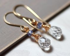 A girl can never have too many pairs of earrings.    Tanzanite and Gold.
