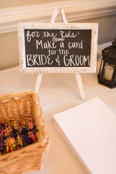 Spring Raleigh Garden Wedding - Kids table idea - crayons + paper to make a card for the bride + groom {Amber Rhodes Photography}
