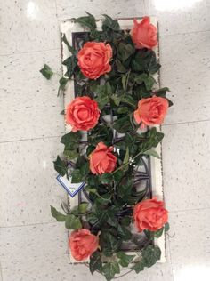 Wooden panel with iron grating intertwined with ivy and roses arrangement for the wall.