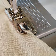 Carol Laflin Ahles explains how to sew a narrow hem, how to guide the fabric, and how to overcome common left-handed feeding problems.