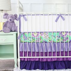 PoshTots: You will love this beautiful bedding and your family and friends will praise your selection. A lovely hint of mint makes this a gorgeous motif for any baby girl's nursery! This set is available with our without a bumper. Our designer crib fabric is bright and beautiful with our exclusive tiered purple ruffle crib skirt.