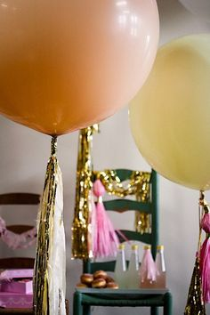 wrap tinsel on bottom of balloons