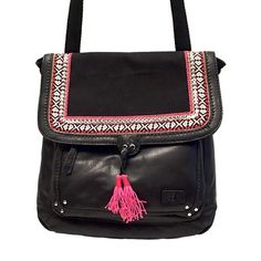 The Sak Ventura Leather Convertible Backpack- New Look hobo chic with this black leather backpack! Backpack can be worn as a messenger bag or backpack. Front flap has snap closure and zip top. Bag has antique silver tone hardware and fun tassel and embroidered edges on flap. Front zip pocket and slip pocket. Interior is lined in the signature lining. Has one zip pocket and two slip pockets. Approx measures 12.5in L x 3in W x 12in H; Drop up to 21 inches.  New with tags! The Sak Bags