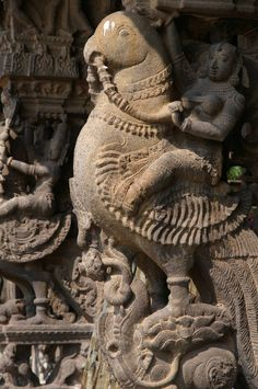 Rati, goddess of desire on her vehicle the parrot