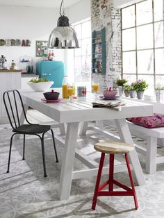 I say yess! love the fridge, light, walls, tables - it just has a happy feeling to it