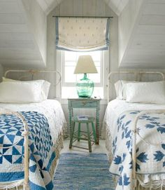 Blue quilts in cottage bedroom