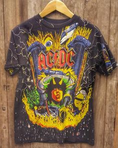 AC DC Vintage Band T Shirt 48 around the chest. If you need another size, send me a message and I will check. In the very rare case you are not pleased, simply return to my Sherman Oaks, California address for a full refund. Vintage Band T Shirts, Sherman Oaks, Fleetwood Mac, Ac Dc, Vintage Looks, My Etsy Shop, Check, Mens Tops, Fashion