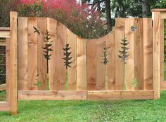 tree bird fish cedar art fence and gate. Love the off-centre curve at the top