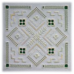 Odessa - Inspired by Ukrainian whitework, this design combines textural surface stitches with pulled work and cutwork.