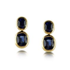 Bespoke pair of two stone sapphire ear drops, mounted in a 9ct yellow gold rub-over setting.