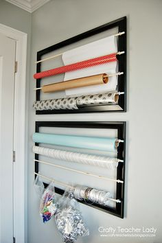 In my craft room: Wrapping Paper Storage using empty frames, cup hooks, and dowels Craft Room Storage, Craft Organization, Diy Storage, Organizing Tips, Organising, Diy Wrapping Paper Organizer, Diy Wrapping Paper Station, Empty Frames, Empty Wall