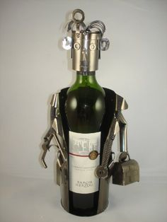 Doctor Metal Wine Bottle Holder by China. $29.99. Contemporary decorative metal wine holder simple but elegent.. Highest quality Iron and Metal with plated black Nikel on surface.. Each piece is uniqulized and reflects personality for a better gift experience. Doctor Wine Holder. Decotative piece is perfect gift to persent a bottle of wine.. Doctor Metal Wine Holder. Save 40% Off!