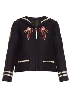 Marc Jacobs brings modern appeal to a classic naval uniform design with this gloriously detailed navy wool and silk-blend jacket. It's embellished with gold and silver sequin mermaids at the sleeves, pretty grey, silver, and red-sequin bows at the front, and is finished with sparkling crystal-studded trims. Build on the nautical theme with the coordinating trousers.