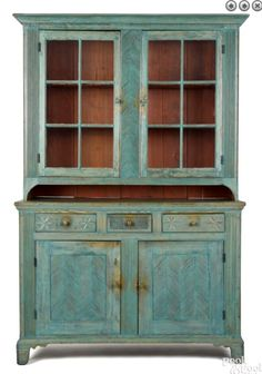 Pook & Pook 10/8/16 Lot: 692. Estimate: $4,000 - 8,000. Realized: $10,200. Description: Pennsylvania painted hard pine Dutch cupboard, early 19th c., purportedly Mahantongo area, with elaborately reeded pilasters, lower doors, & star carved drawers, retaining a later blue surface, 81-1/2'' h., 52-3/4'' w. Provenance: Titus Geesey. Condition: Overall good condition. A few repaired breaks to foot facings & cornice. Several pieces of glass replaced. Paint is mid 20th c.