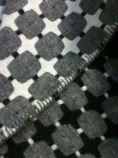 Eleanor Pritchard  http://www.cadesign.ie/furniture/eleanor-pritchard-blankets/black-and-grey-line-blanket/