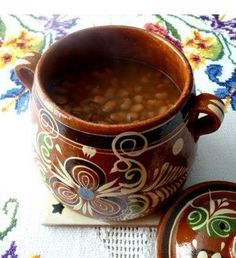 Frijoles de la olla are made with water only.  My nana did not add salt until they were tender. Serve them in a bowl with shredded cheese, cilantro & a bit of onion.  Buen Provecho!
