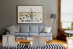 love the soft gray of these walls with the blonde wood floors and darker wood trim by BigVal