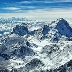 The view from the summit of Everest looking East. The prominent peak to the right is Makalu (8485 metres) - The fifth highest mountain in the world. On the far horizon rises Kanchenjunga (8586 metres) - The third highest mountain in the world.