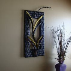 And its made with recycled bike tubes....MAKE THIS FOR A FRAME AROUND A BASIC MIRROR IN THE WORK OUT ROOM.