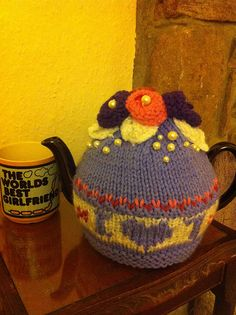 Ravelry: ElizabethLihou's I LOVE T tea cosy: Finished it with my broken pearl necklace, flowers, Swiss darning etc.