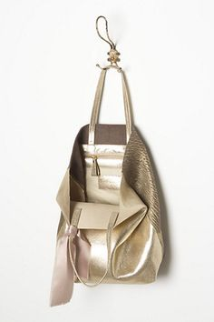 This is beautiful! Maybe I'm having a thing for soft-not-too-yellow golds. Elegant yet unstructured. Hammered Gold Tote - Anthropologie.com
