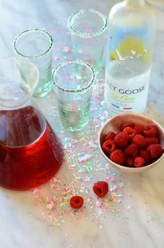 1 1/2 oz pear vodka   1 1/2 oz pineapple juice, chilled  1 1/2 oz cranberry juice, chilled  2 raspberries for garnish