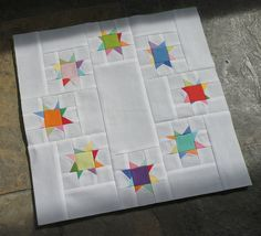 "Same circle of stars, but now a small 12"" block!!! Link to directions inside...still love brights on white!"