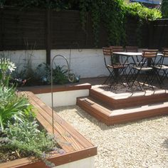 Like this quaint terraced design for backyard space...