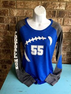 Football Mom Shirt with # on front Football mom shirts RUNS SMALL customized with # - Boymom Shirt - Ideas of Boymom Shirt - Football Mom Shirt with # on front Football mom shirts Long Sleeve preppy Tee customized with # Football Mom Shirts, Football Outfits, Youth Football, Sports Shirts, Sport Outfits, Football Moms, Football Quotes, Football Stuff, Football Program
