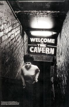 "8-7 in 1957: The Quarrymen (minus new member Paul McCartney, away at Scout camp!) make their debut at Liverpool's Cavern Club. It was a lunchtime show. Manager Alan Sytner instructs them not to play rock and roll, (The Cavern was a jazz club at the time), but midway through their skiffle performance, John lights into a version of Elvis' ""Don't Be Cruel,"" which the crowd loves."