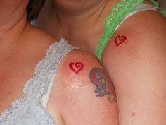 sister tattoos i like the small hearts