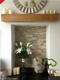 Timber shelf & open fireplace.