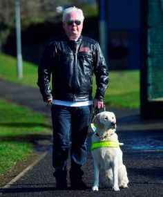 James Cosgrove, 51, with his guide dog Imogen, he was turned away from a restaurant in Bangor because he was with his guide dog Photo: Colm Lenaghan/Pacemaker Press/PA Wire