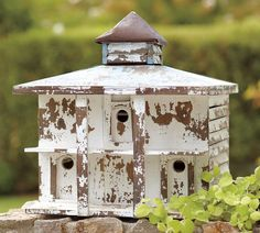 A Beautiful White Washed Birdhouse
