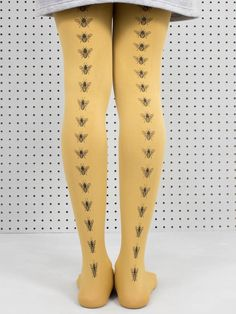 We are proud to be stocking Brighton label Hose Tights! These amazing 100 denier mustard tights are hand screen printed with small bees along the back. Machine