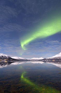 Aurora reflections : A beautiful calm winter evening near Tromsø in Arctic Norway