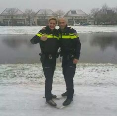 Dutch police Ice skating on the frozen street in Holland