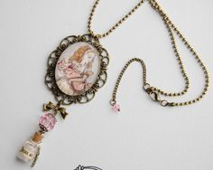Alice in Wonderland DRINK ME hand made necklace with glass cabochon glass mini bottle key
