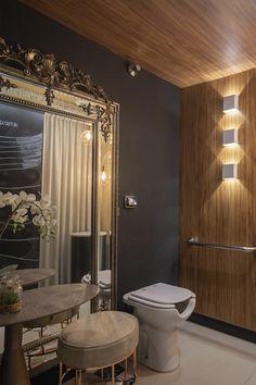 Aqui temos um banheiro que já possui alguns elementos diferentes, mas a nossa atenção é direto para elas: as Arandelas.