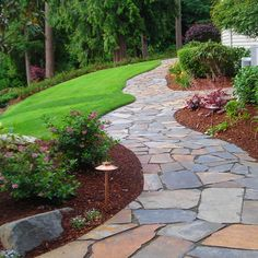flagstone sidewalk.. This is beautiful. It goes with any color schem of the home.