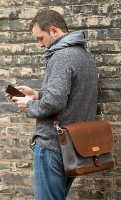 Dress in Grey Turtleneck, Grey Scarf, Brown Grey Leather Messenger Bag, Blue Denim Jeans and on can complete this outfit by wearing White Sneakers