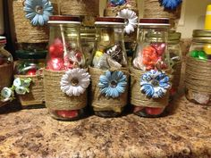 Starbucks bottles and glass jars designed with twine and paper flowers. Good as party favors