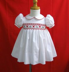 White handsmocked dress with hearts and holly beautiful for Christmas 12Mo.
