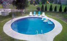 Modern round inground pool designs with landscape