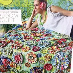 Amy Butler flower yo-yo quilt - they don't have to be the same size and lined up in rows - what an impact !