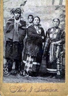 L-R: Isaac McCoy (Ottawa) with his wife, Mary Thorpe-McCoy (Sac & Fox) holding their grandson (Ottawa/Sac & Fox), and Mary's mother (Sac & Fox) - 1894